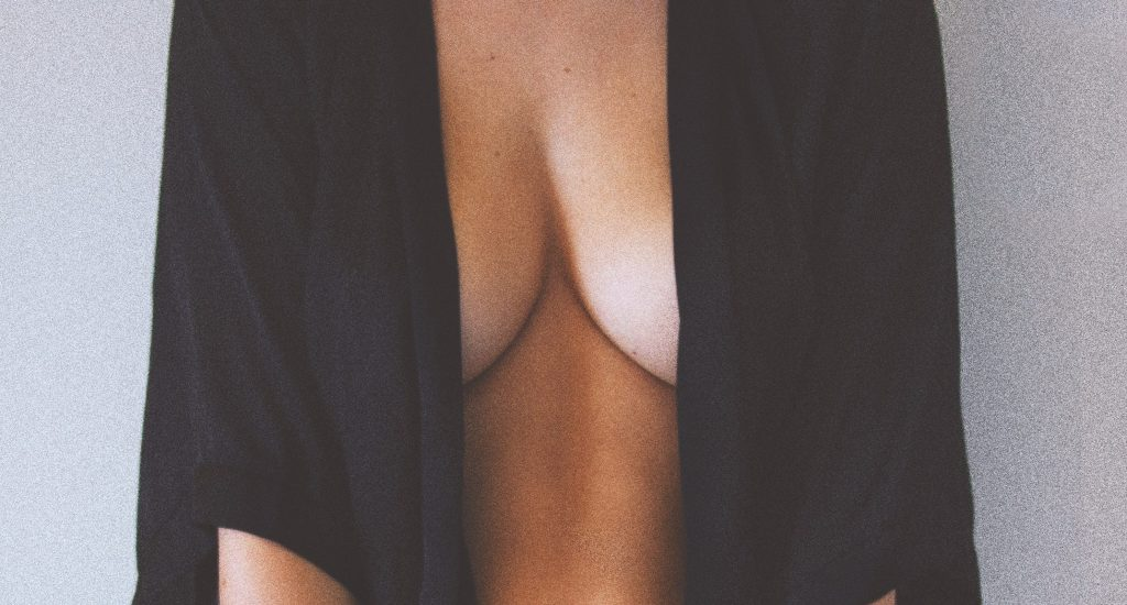 cleavage of woman with breast implants and possible bia-alcl