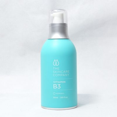 A blue bottle of Vitamin 3 Serum.